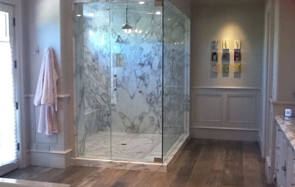 Bookmatched slab marble shower and countertops